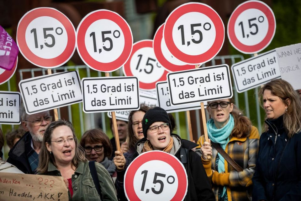 Activists in Berlin stood with signs calling for limiting global warming